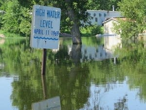 A sign showing the all-time flood crest of the west fork