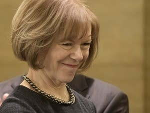 Minnesota Gov. Mark Dayton appoints Tina Smith to Al Franken's senate seat.