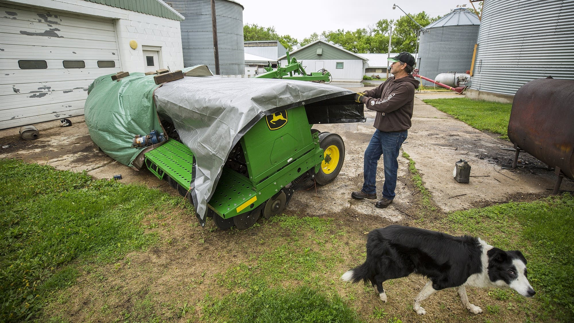 Dave Lochen covers up a machine that he will use to plant cover crops.