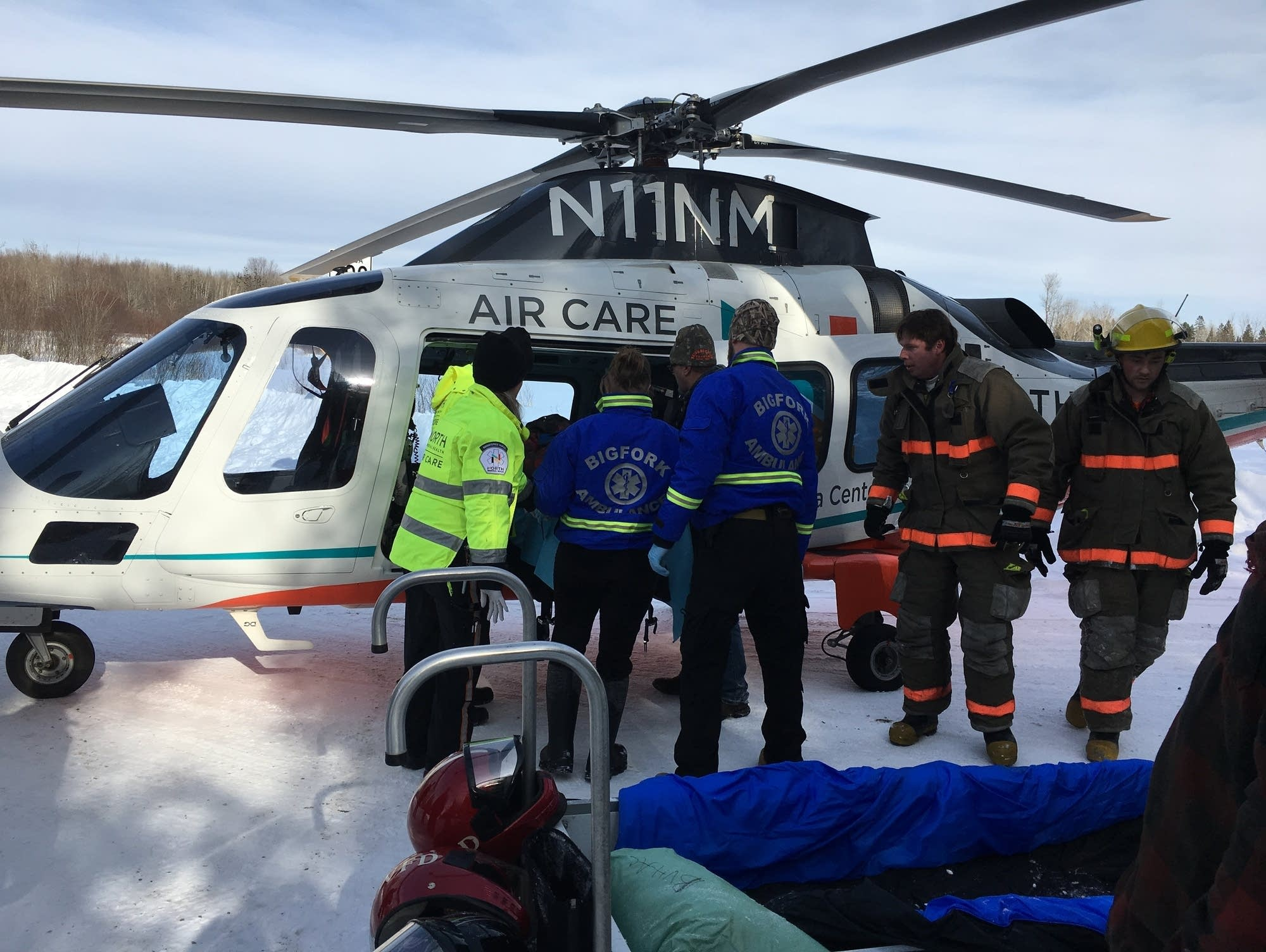 A snowmobile operator is airlifted.