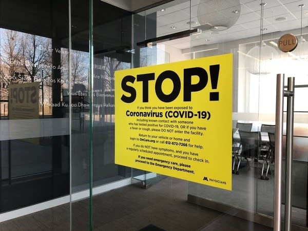 "A sign on a door of a clinic reads ""Stop!"""