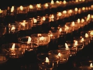 Candles burning in the dark.