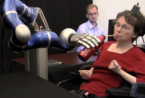 Woman using robotic arm
