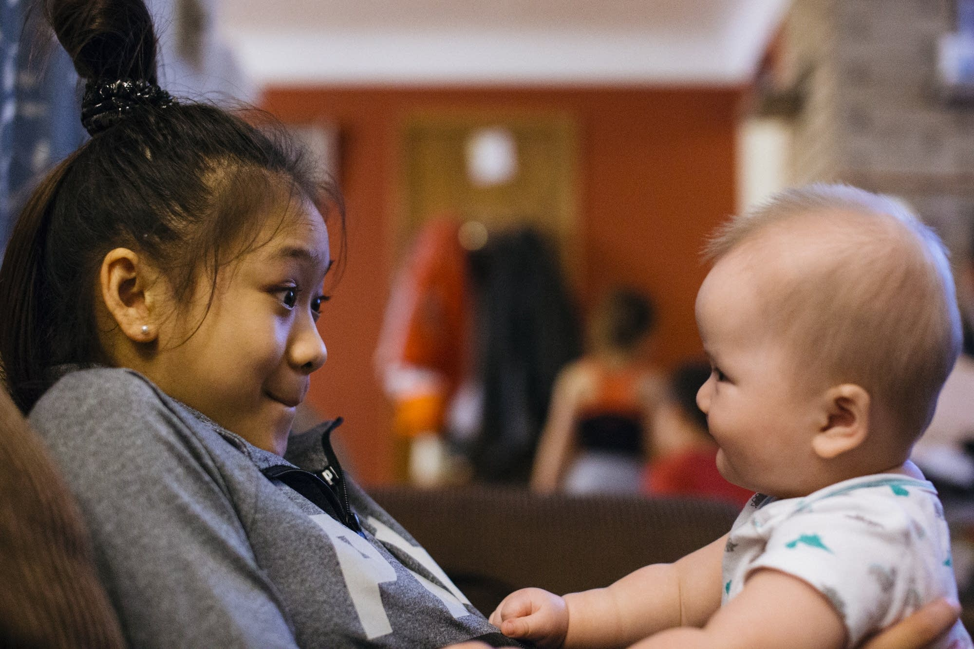 Sunisa Lee plays with her little brother.