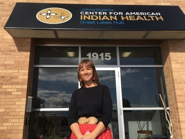 A woman stands in front of an office in Duluth.