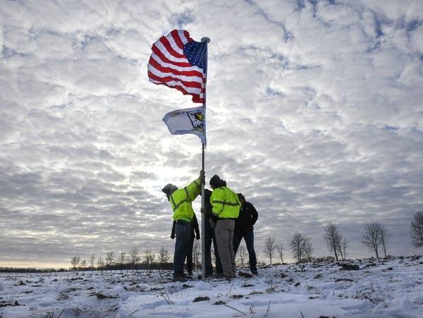 Members of the Krippner family raise a flag