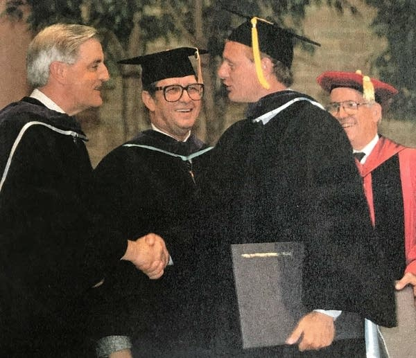 Walter Mondale congratulates his son Ted at the commencement.