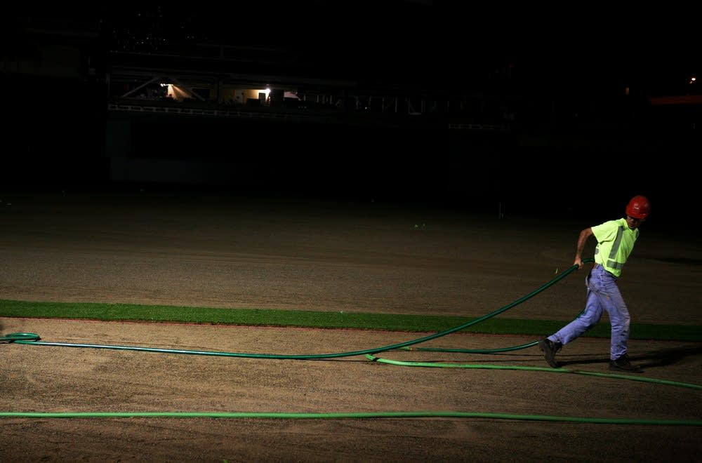 Worker prepares first strip of sod