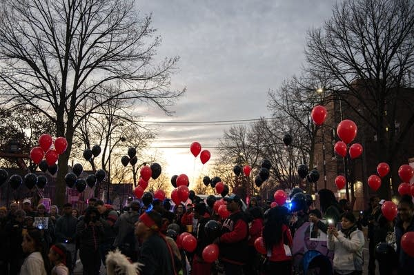 People release balloons to honor Jamar Clark.