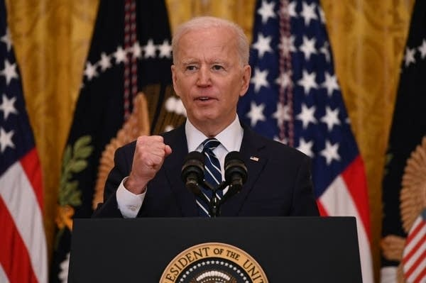 President Joe Biden speaks to reporters during his first news conference.