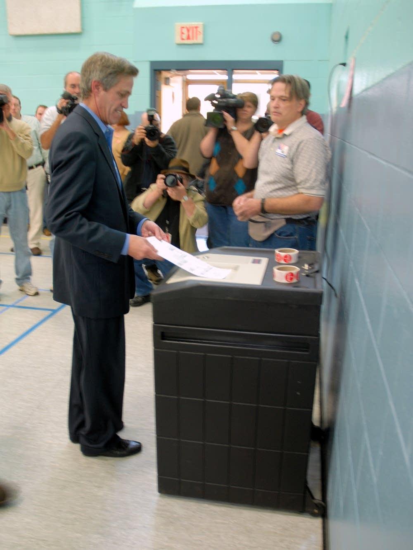 Norm Coleman voting