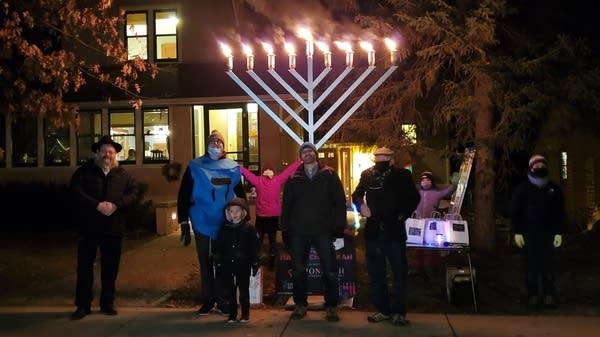 A drive-through menorah lighting event.