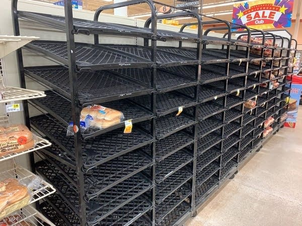 At Cub Foods in West St. Paul, shelves for bread are seen empty.