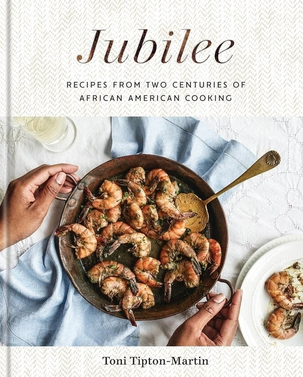 Jubilee book cover with shrimp dish placed on table