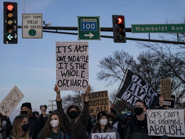Demonstrators block an intersection