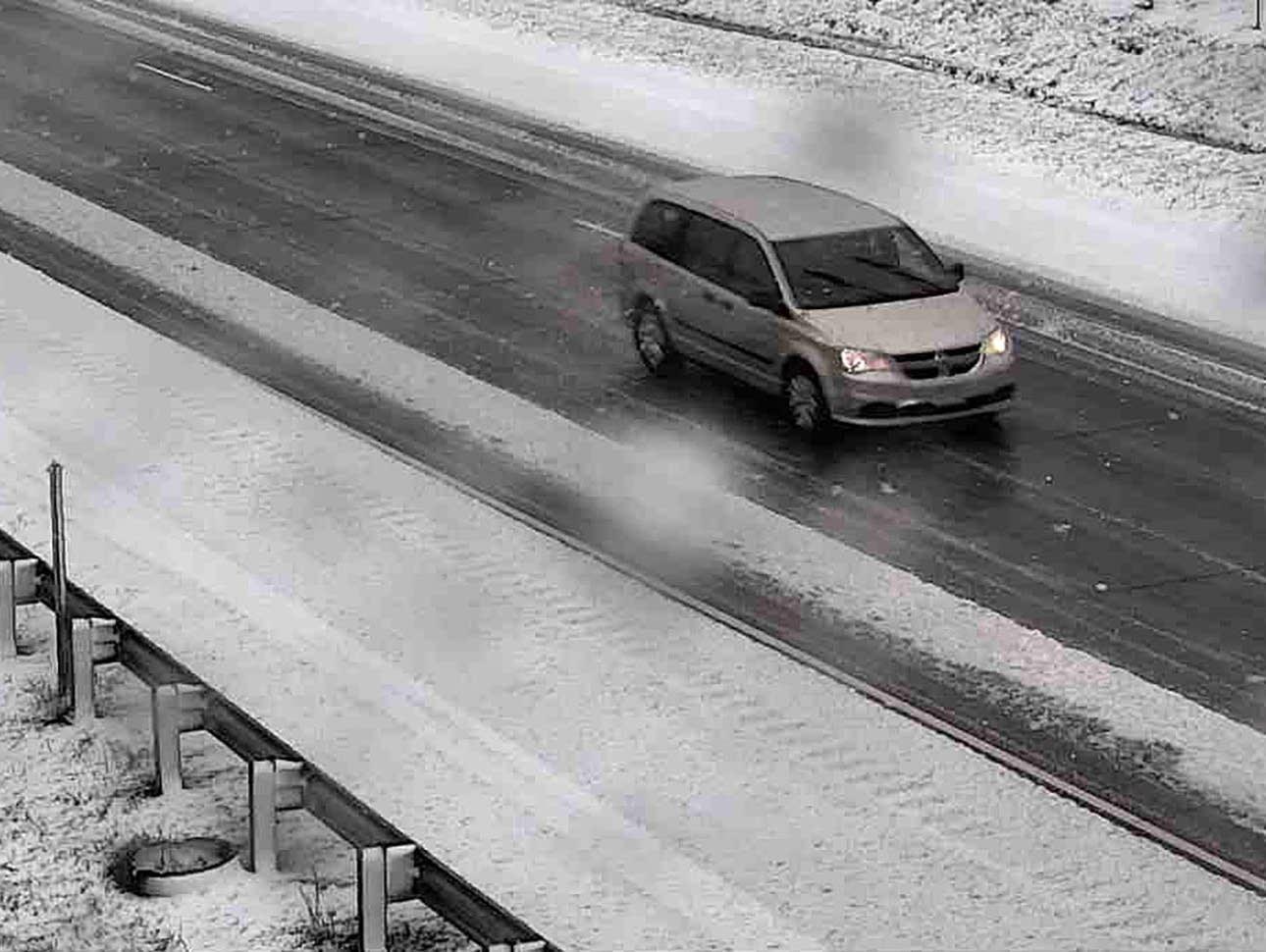 Snow accumulates along Interstate 35