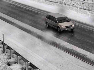 Snow accumulates along Interstate 35