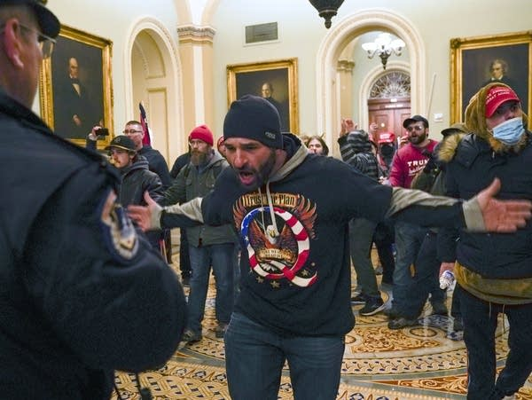Pro-Trump rioters gesture to U.S. Capitol Police