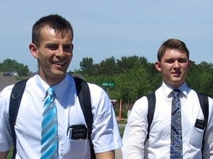 Tanner Smedley and Joseph Smith head into Detroit Lakes, Minn., on foot.