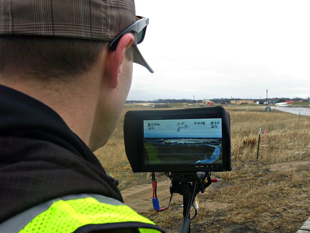 Joey Schmit monitors live video from his drone.