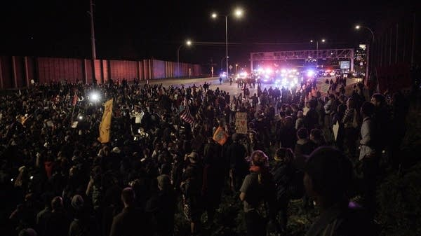 Hundreds block I-94 in both directions.