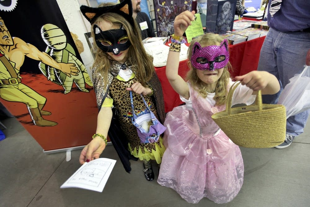 Supercat and Pinky hand out comics they wrote.