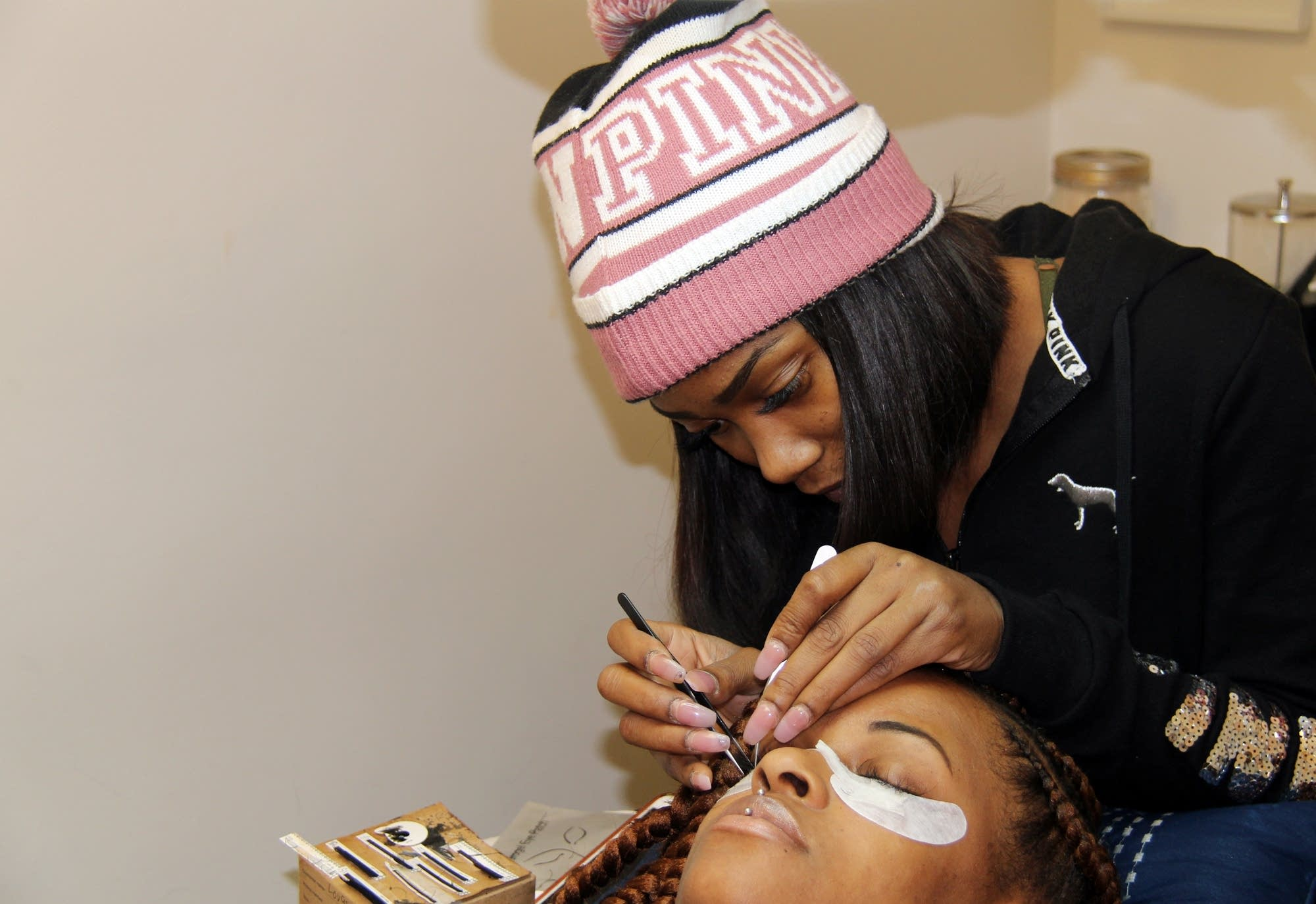 """Shae"" London  does a bi-monthly eyelash fill for Rodneshia Hawkins."