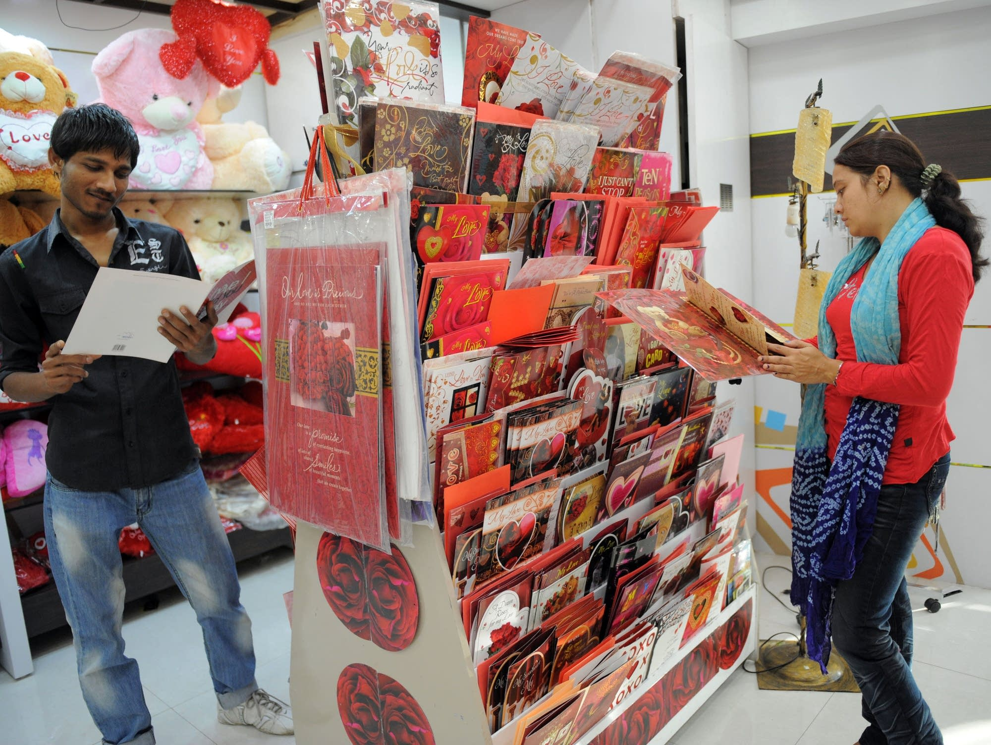 Customers Look Through Greeting Cards