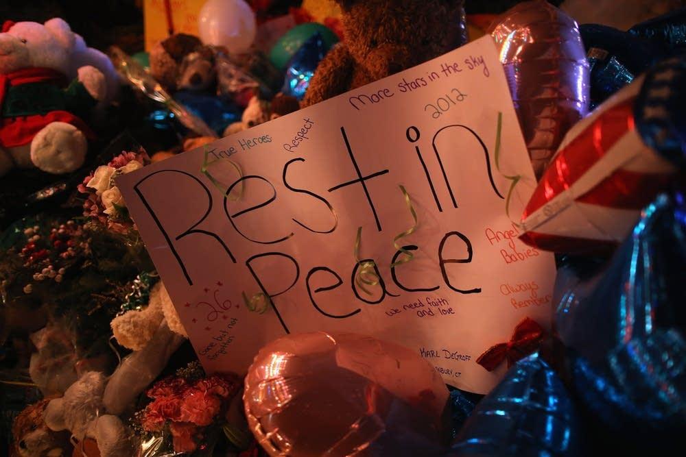 A sign adorns a memorial
