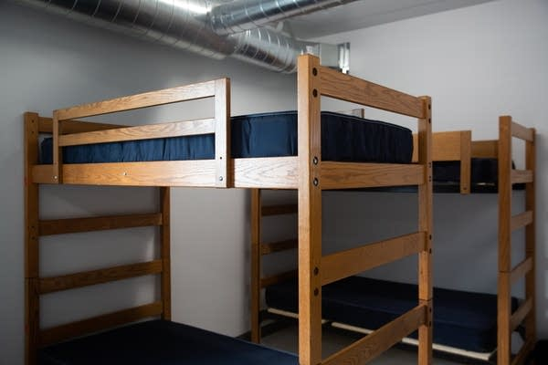 Bunkbeds sit in a white room.