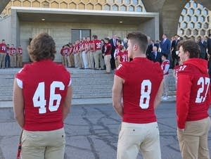 St. John's football players line up outside of the Abbey Church.
