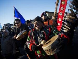 Dan Nanamkin drums with a procession