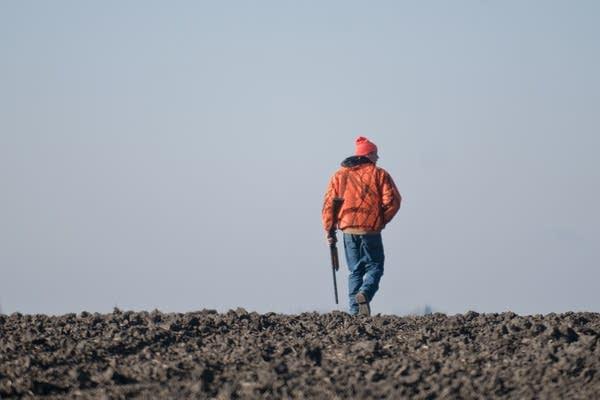 Darin Stenzel walks out on a plowed field.