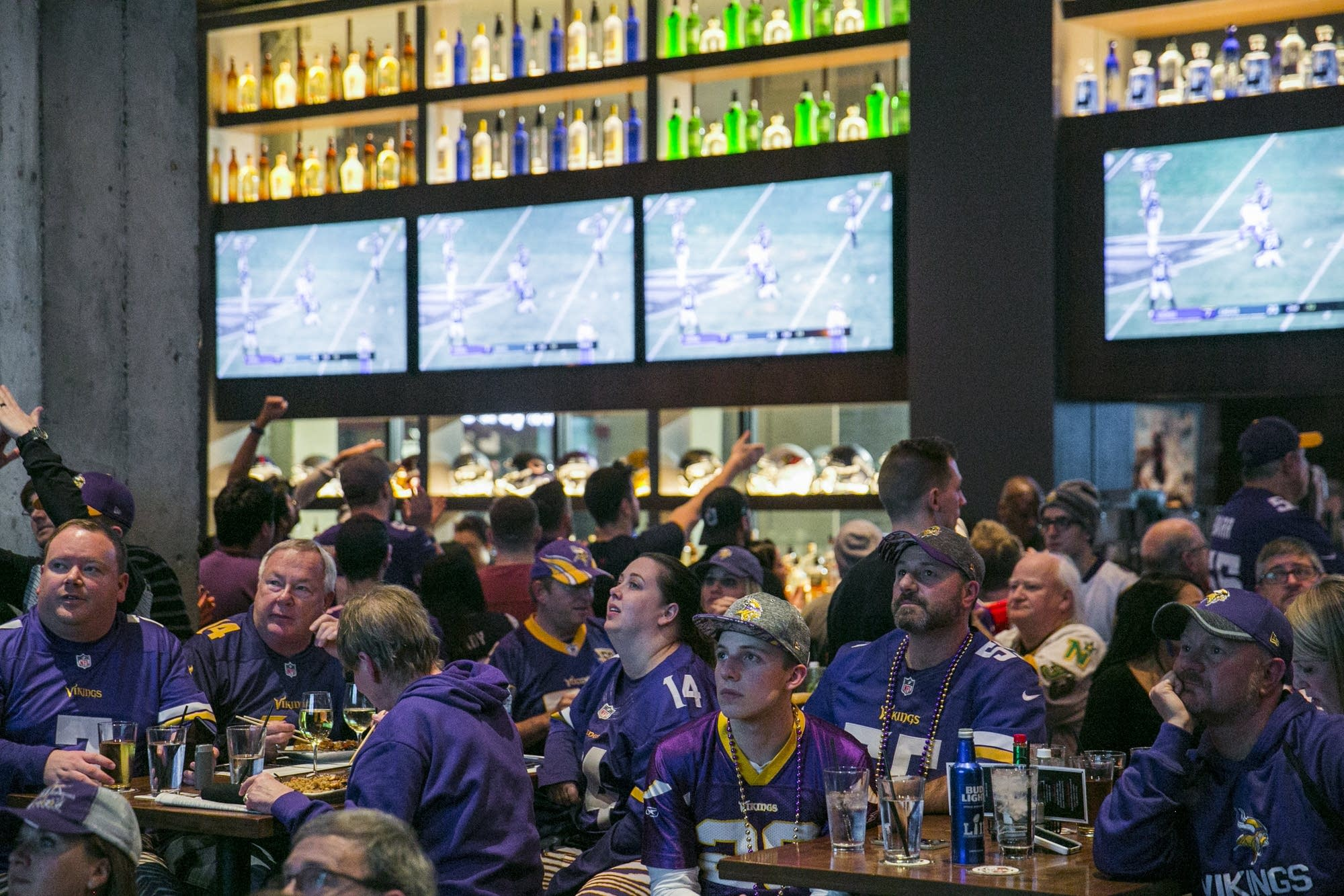 Vikings fans pensively watch the 2nd quarter of the NFC championship game.