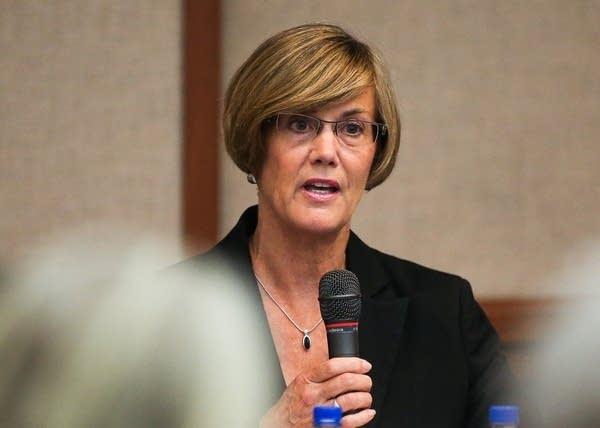 Candidate Kim Norton speaks during a forum.