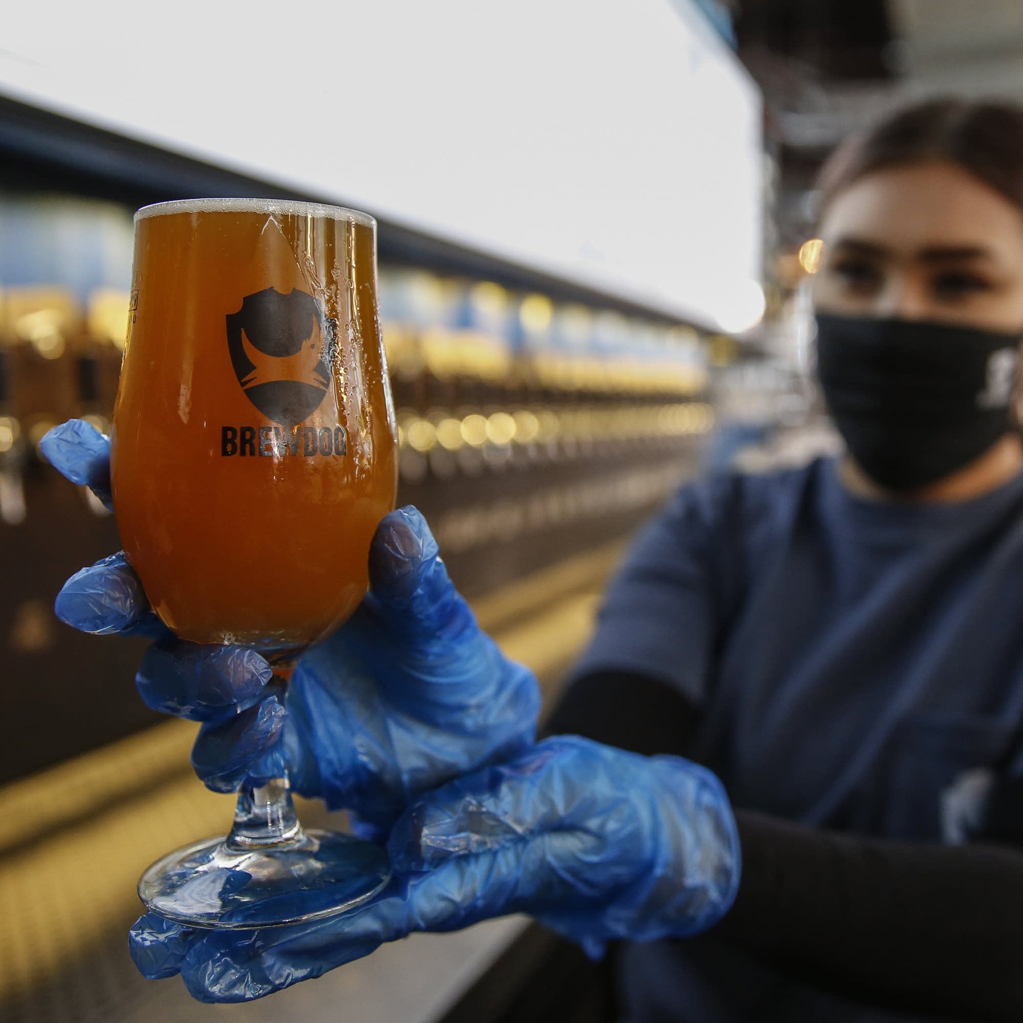 A brewery in London prepares to reopen with safety measures in place.
