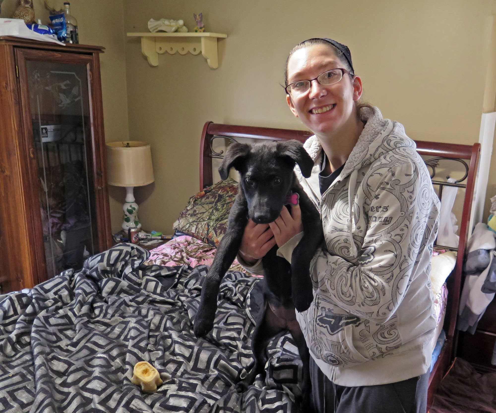 Brittany Dubbels poses with one of her dogs in her Rochester apartment.