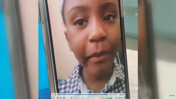 A recorded video shows a girl speaking to a camera