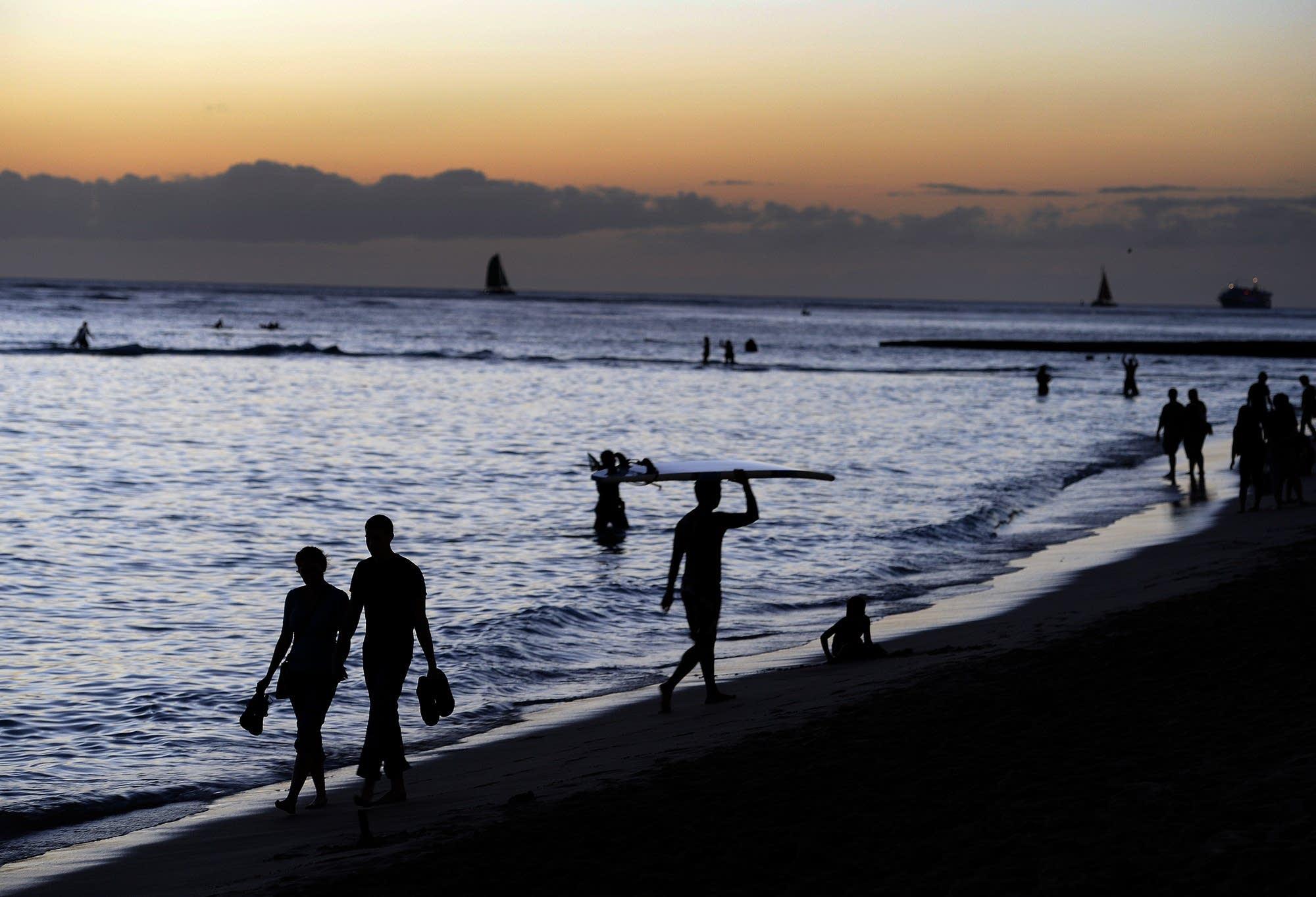 Tourists enjoy Waikiki beach.