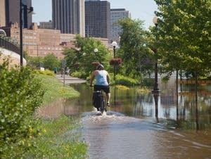 Biker wades through flooded Mississippi