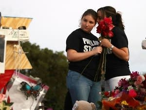 Students place flowers at Marjory Stoneman Douglas High School