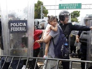 Migrants traveling in a mass caravan.