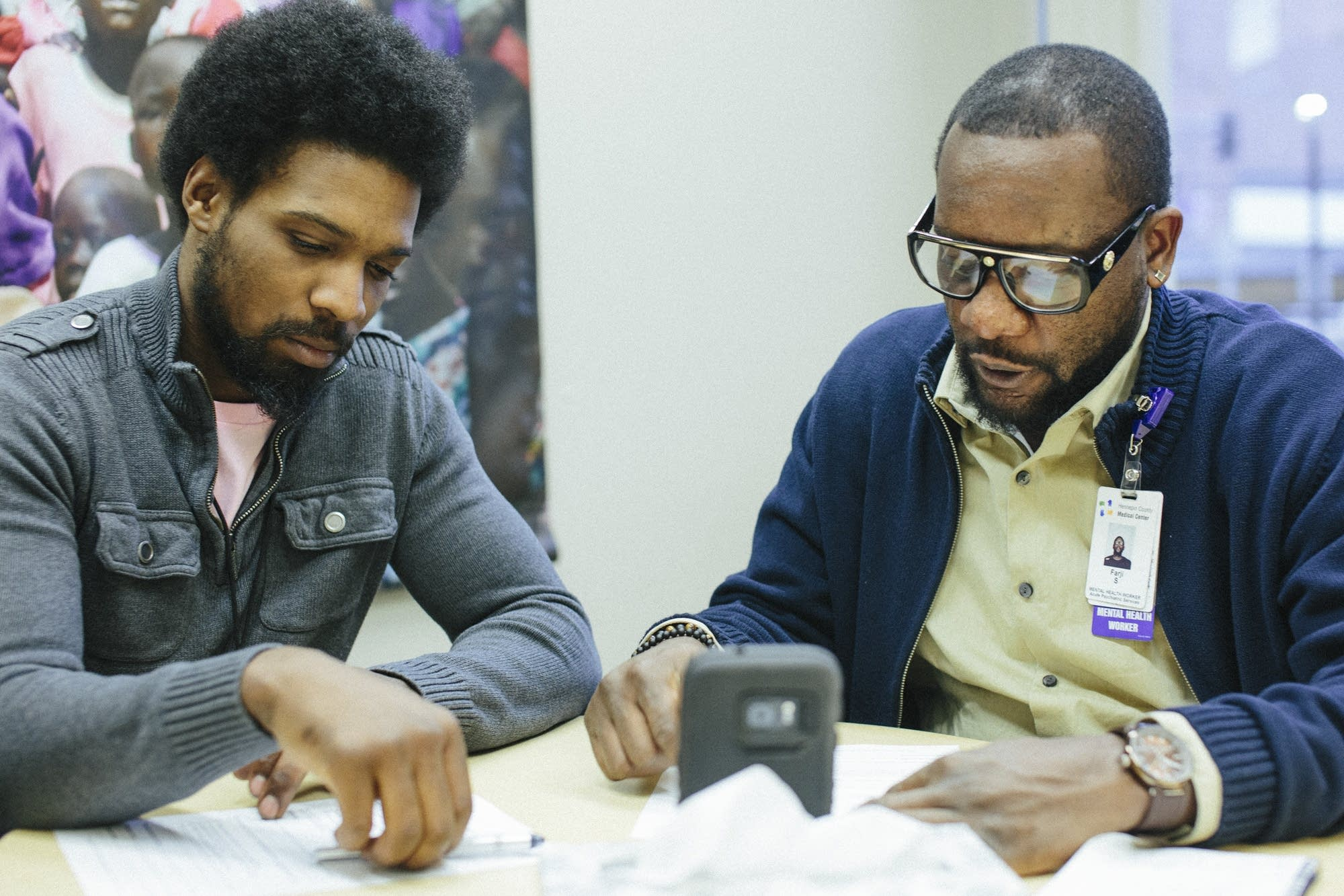D'Andre Alexander, left, and  Farji Shaheer watch a video.