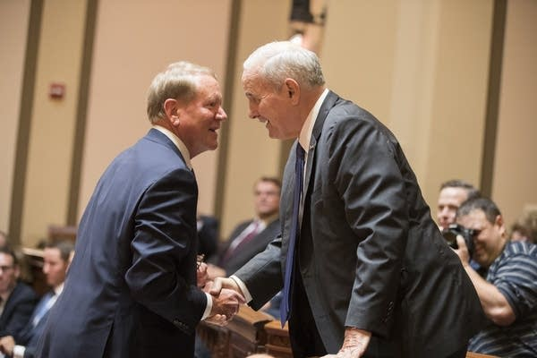 Gov. Dayton, right, greets Doug Kelley, representing the legislature.