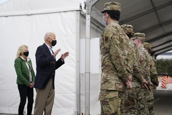 President Joe Biden and first lady Jill Biden meet with troops