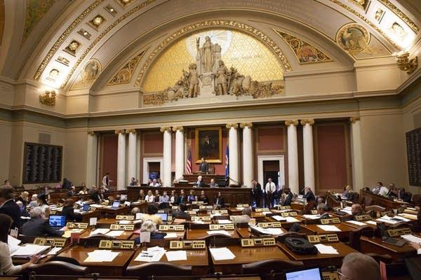 Legislators debate a bill on the house floor.