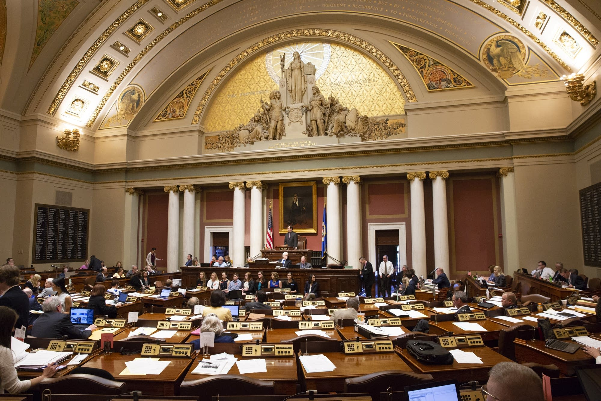 Legislators debate a bill on the house floor.