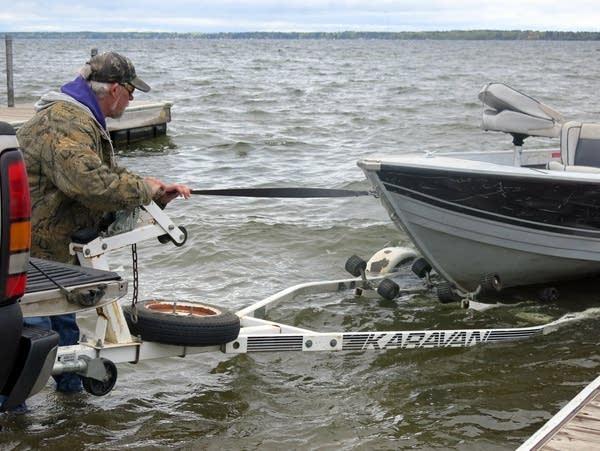 Rick Carlson pulls his boat from Lake Bemidji.