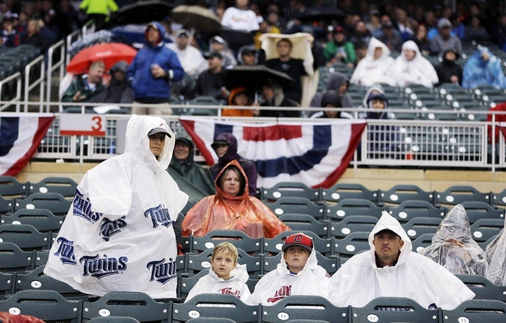 Fans look on during a rain delay