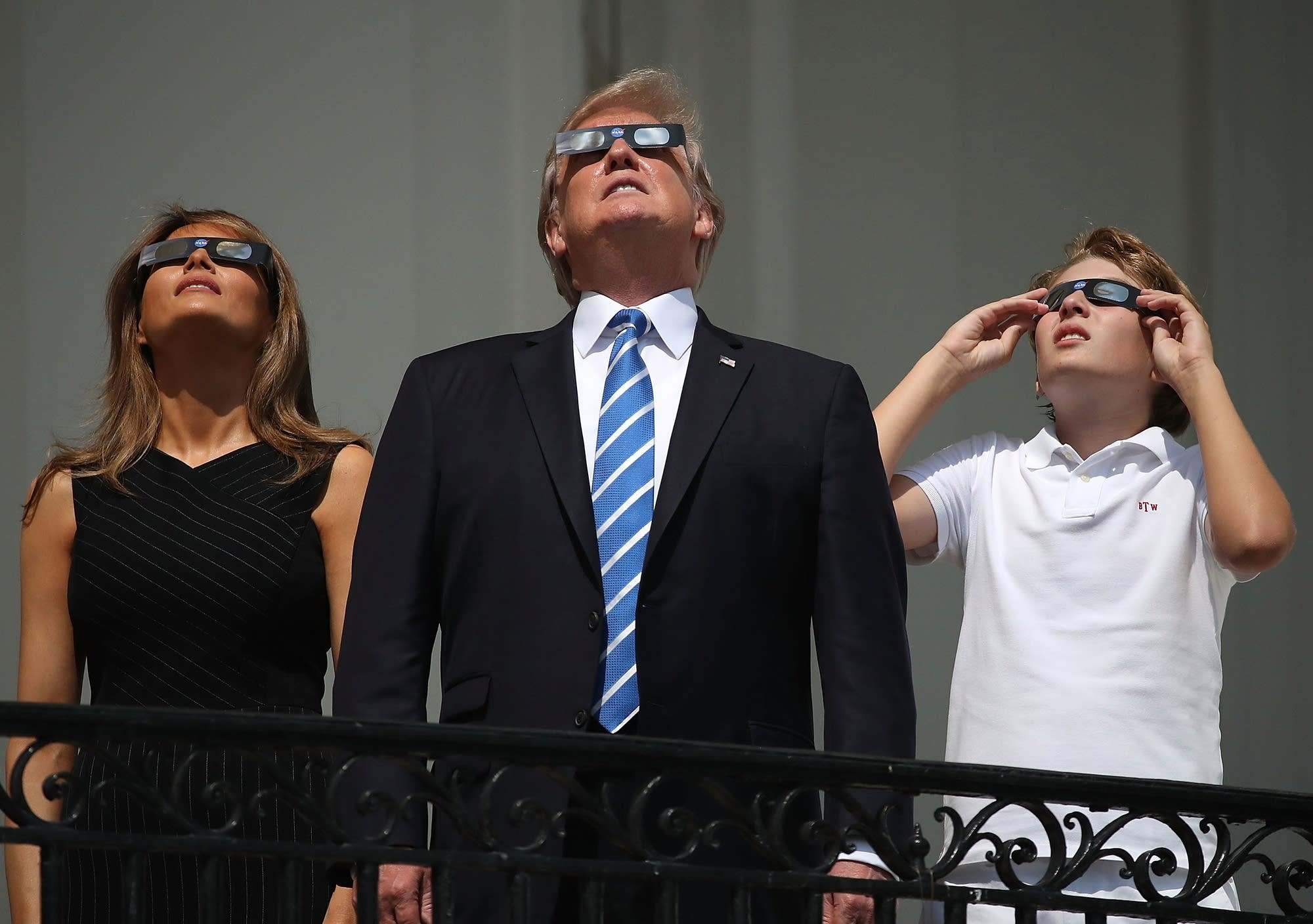 Pres. Trump, Melania and Barron Trump view the  eclipse at the White House.